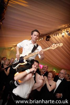 bogus brothers band guitarist on shoulders