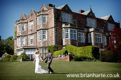 wedding couple walking goldsborough hall
