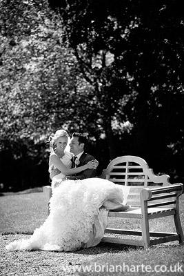 bride sitting on grooms lap