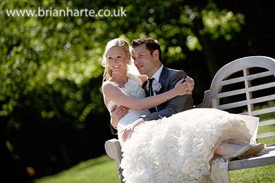 wedding couple sitting on bench goldsborough hall