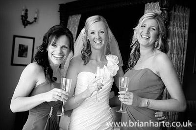 bride with bridesmaids fun at goldsborough hall