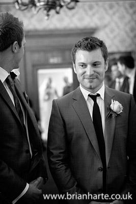photo of groom when bride walking down aisle